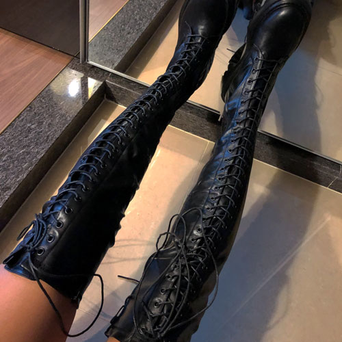 Knee-high eyelet boots